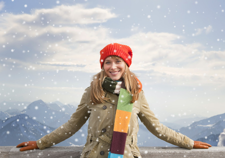 snowed: Woman smiling outdoors in snow