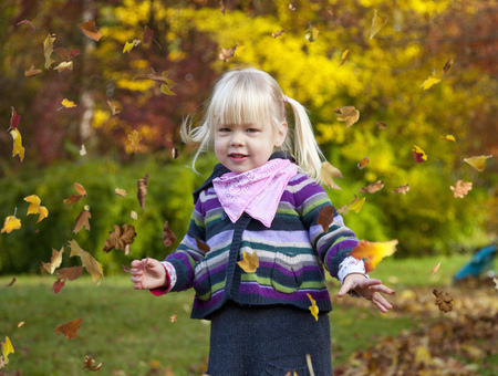 three leafed: Girl playing in fall leaves
