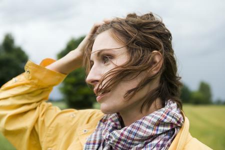 wind blown hair: Smiling woman walking outdoors