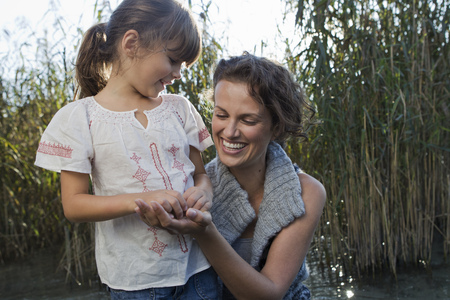 bogs: Mother and daughter talking in pond