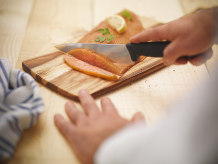 coldblooded: Chef slicing salmon in kitchen