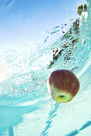 uncomplicated: Apple floating in swimming pool