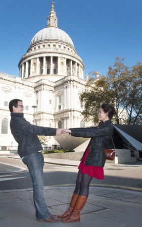 leaning by barrier: Couple outside St Paul's Cathedral
