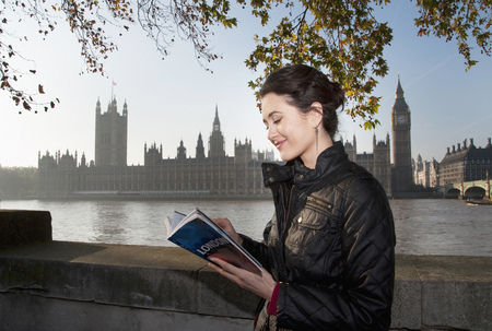 governed: Woman reading guidebook of London