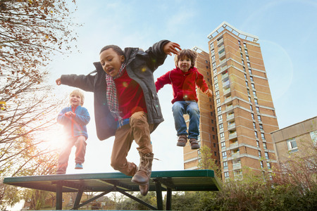 Children jumping for joy in park