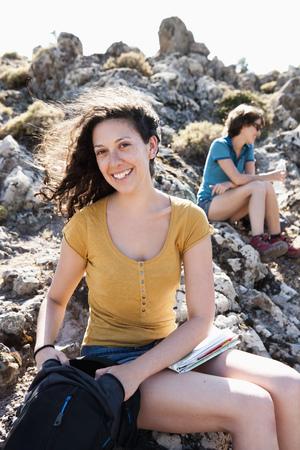 Hikers resting on rocks LANG_EVOIMAGES