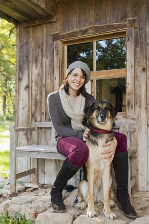 fondling: Woman petting dog on porch