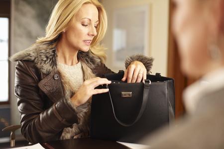 Woman rummaging through purse