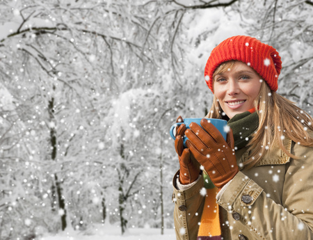snows: Woman drinking coffee in snow