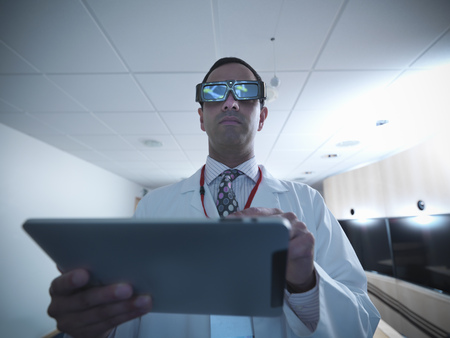 rd: Scientist wearing 3D glasses in lab