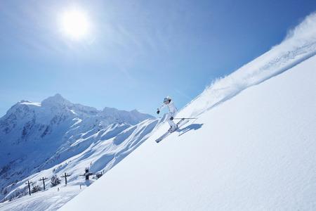 north western european descent: Skier coasting down snowy slope