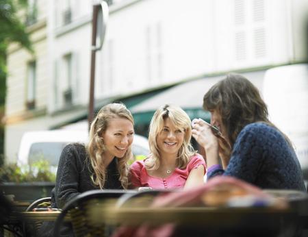 tea breaks: Women having coffee at sidewalk cafe LANG_EVOIMAGES