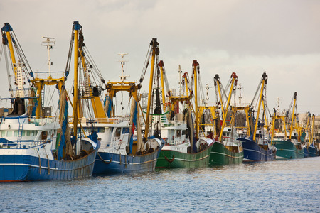 conforms: Trawler fleet docked at pier LANG_EVOIMAGES
