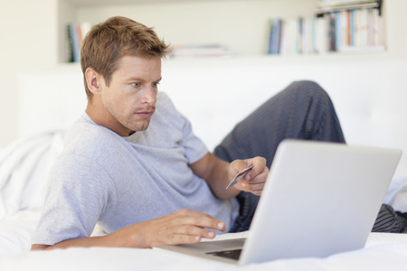 require: Man shopping online with laptop