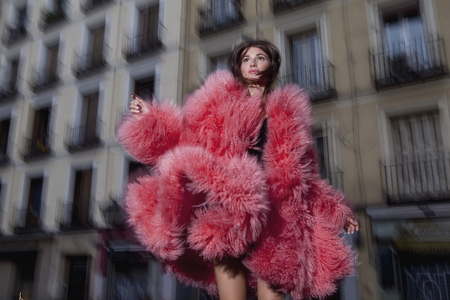 furs: Woman modeling clothes outdoors LANG_EVOIMAGES