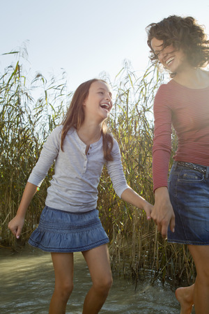 bogs: Mother and daughter walking in pond