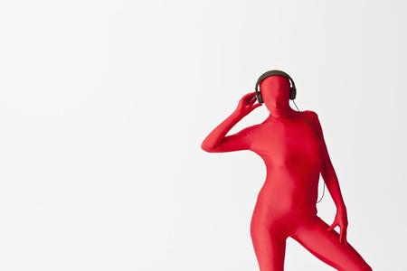 Woman in bodysuit wearing headphones