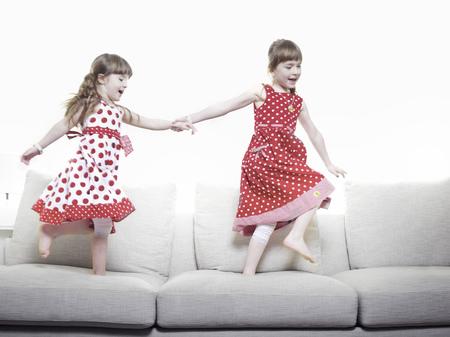 Girls playing together on sofa
