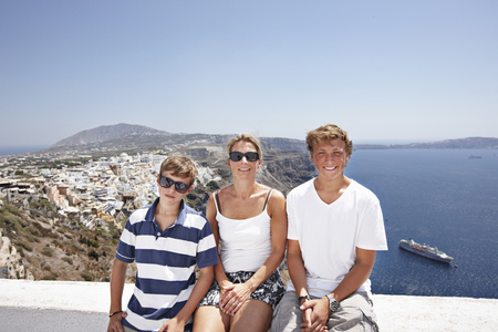clear waters: Family smiling on balcony together