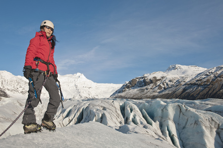 Climber walking on glacier LANG_EVOIMAGES