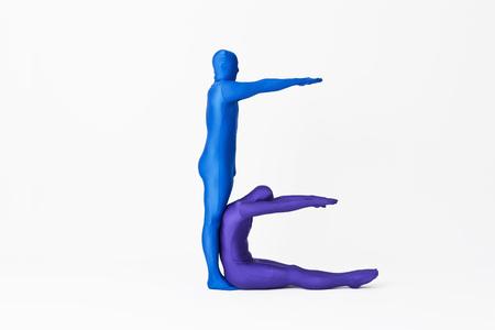 limber: Men in bodysuits making the letter E