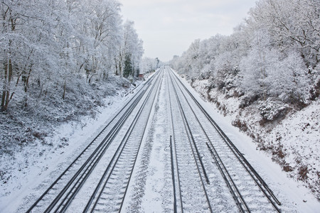 Train tracks in snowy rural landscape LANG_EVOIMAGES