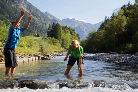 whimsy: Couple wading in rocky rural creek