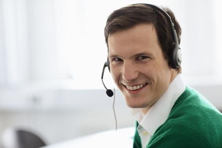 Businessman wearing headset in office