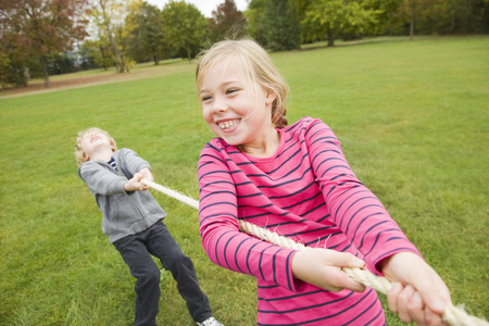 struggled: Children playing tug-of-war outdoors