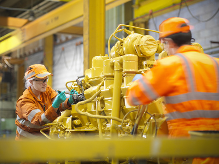 defended: Apprentice engineers at work in factory