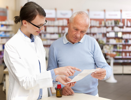 dubious: Pharmacist talking to patient in store