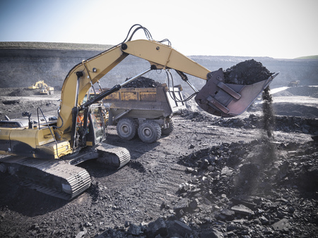 mined: Digger scooping coal at mine