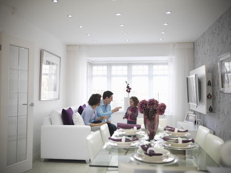 talker: Family relaxing together in living room