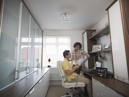 women's issues: Couple talking in home office