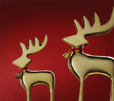 equivalents: Close up of gold reindeer with bells