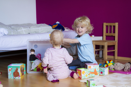 spirited: Siblings playing together in bedroom