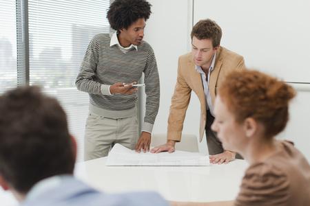 interrogations: Businessmen talking in meeting