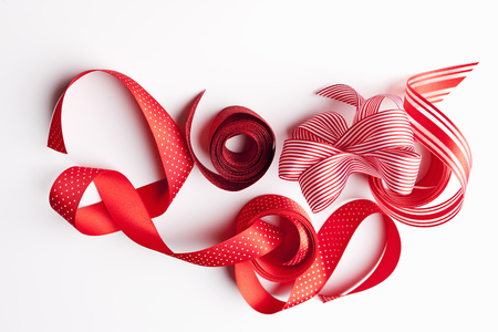 enclose: Close up of decorative red ribbons