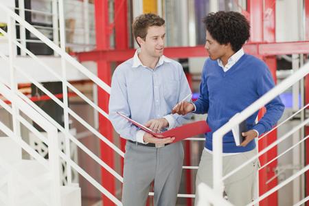 conferring: Businessmen talking in office