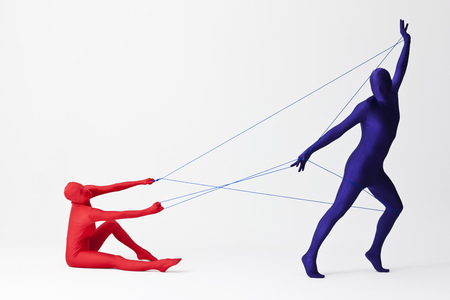 captives: Couple in bodysuits playing with string LANG_EVOIMAGES
