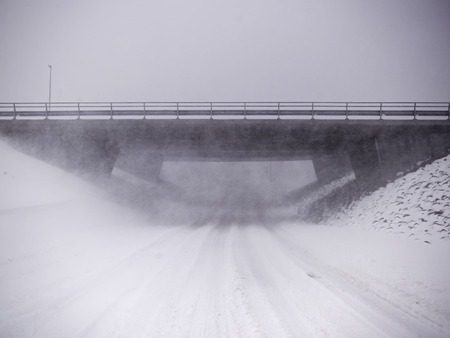 snows: Snowy overpass in rural landscape