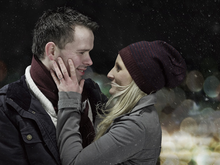 snows: Couple hugging outdoors at night