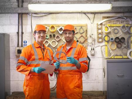 2 50: Engineer teaching apprentice in factory