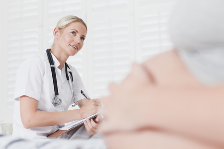 Doctor talking to pregnant woman