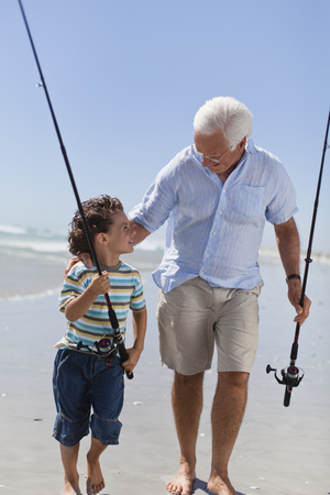Man and grandson with fishing poles LANG_EVOIMAGES