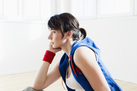 Woman sitting on floor after workout