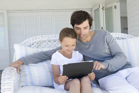 shared sharing: Father and daughter using tablet