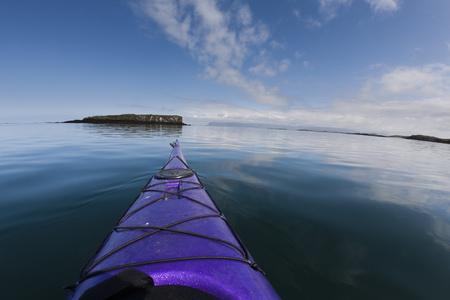 Nose of kayak on still lake LANG_EVOIMAGES