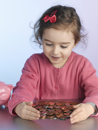 assembled: Girl playing with pile of coins
