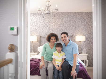 45 50 years: Family smiling together in bedroom